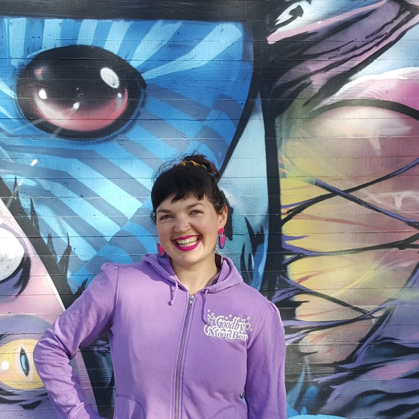 Conference Organising Committee Member, Pixie Stardust in front of street art